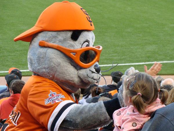 Lulu high-fiving Lou Seal, Giants Mascot